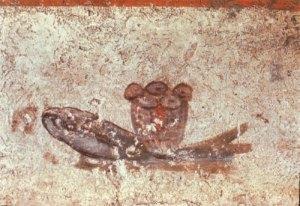 El símbolo eucarístico de los panes y los peces. Catacumbas de San Calixto. Roma