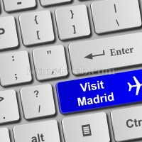Visit Madrid keyboard button. Buy online tickets concept to visit Madrid - Icons for your website