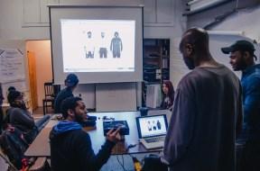 Leomar asks Bayeté a question during his visual presentation. Credit: Alex Joseph