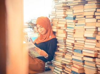 Pretty muslim girl in library