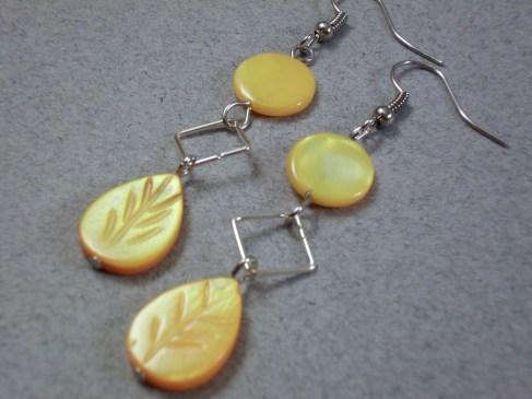 Flat coin orange mop leaf earrings
