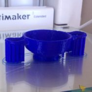 The kylix being printed on a 3D printer, including supports for the handles