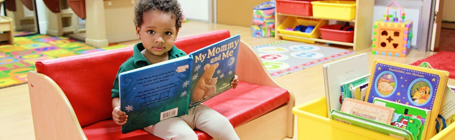 Kid Reading at the ICS Coral Gables Daycare