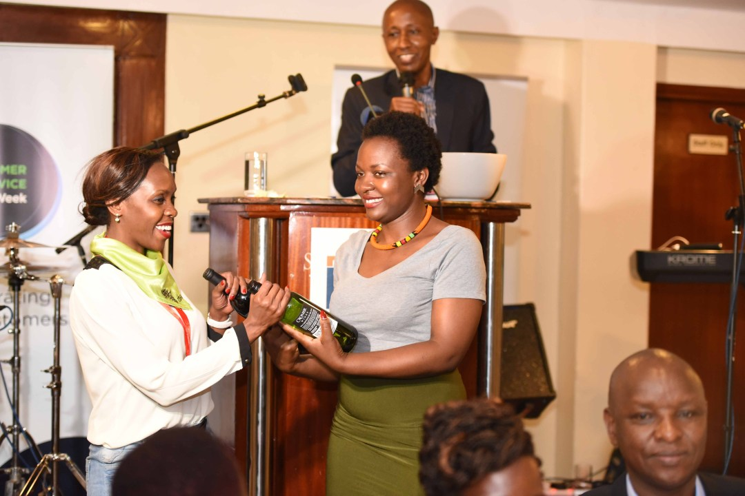 Catherine-Oyuo-CBA-receives-bottles-of-wine-after-winning-the-Customer-Service-Quiz