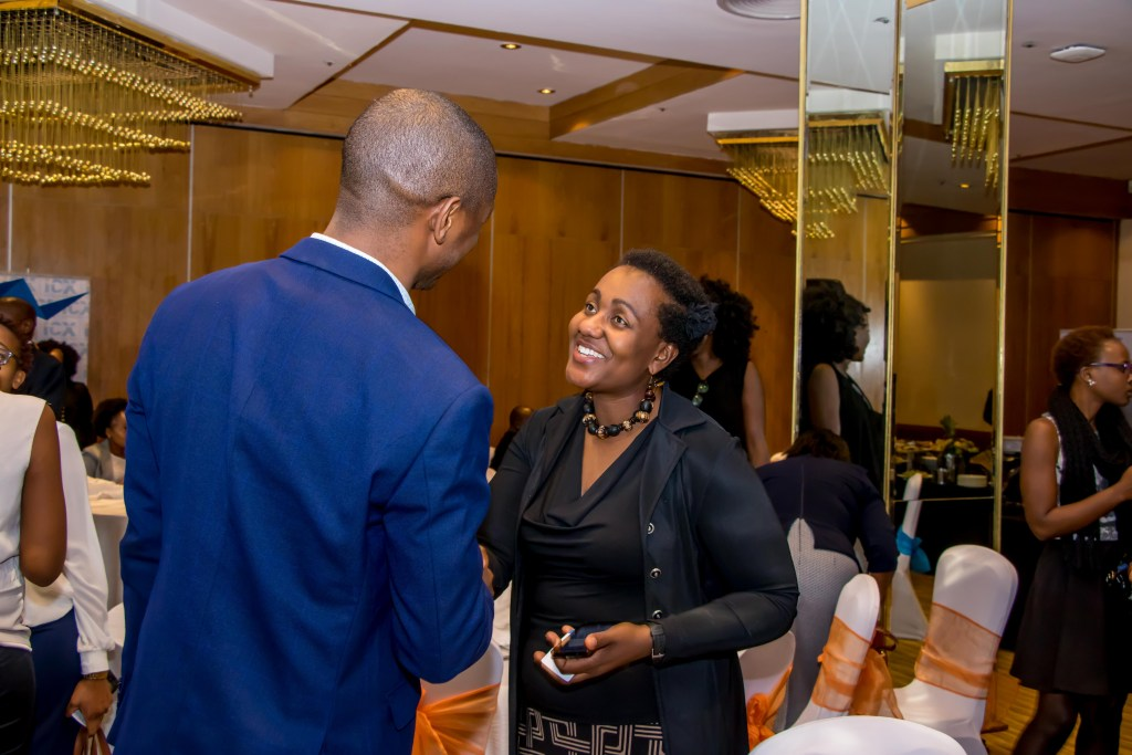 Carolyne Gathuru an ICX Kenya Board member networking with members.