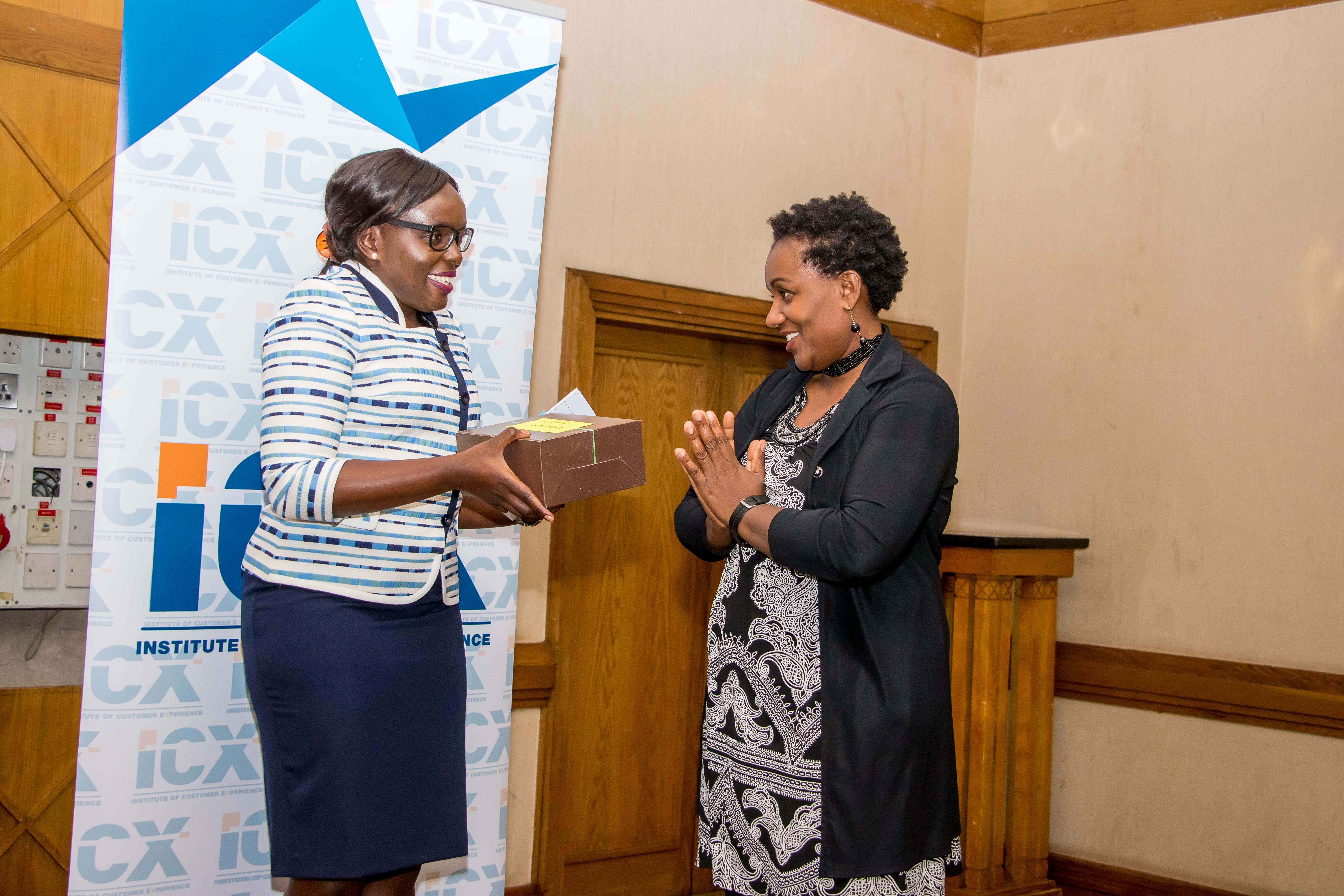 ICX Board Member, Carolyne Gathuru, appreciating the Guest speaker - Ms. Grace Wandera for delivering an earth moving presentation