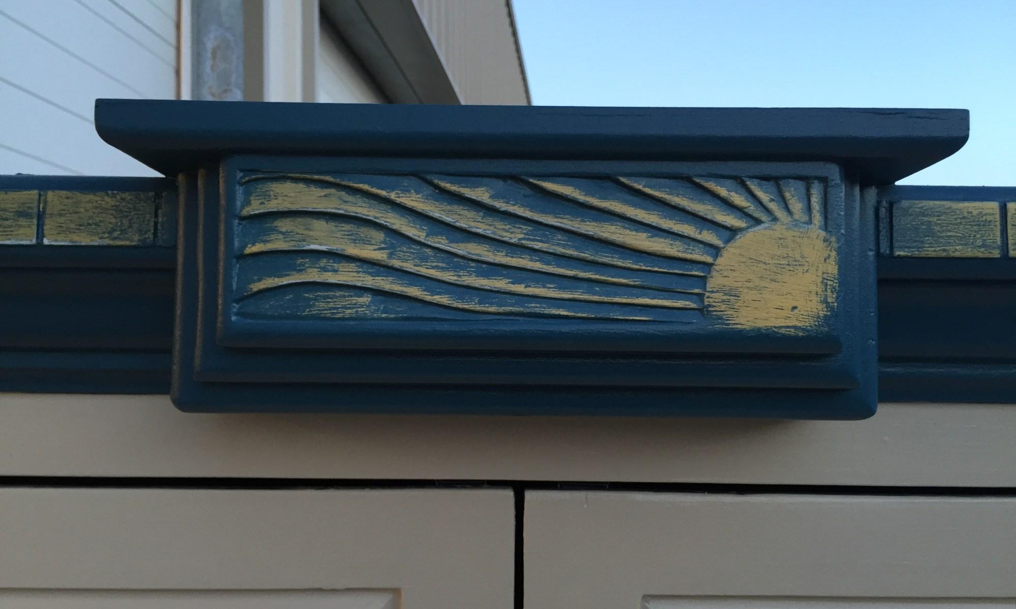 sun armoire - sun carving