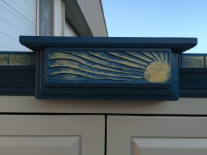 sunburst-carved-into-armoire