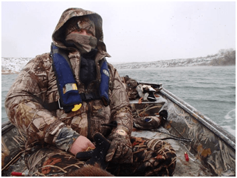 Waterfowl hunter, angler bundled up
