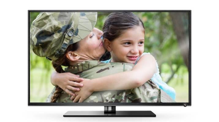 Veteran Woman Holding Daughter on TV