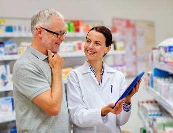 Pharmacist helping senior with prescriptions