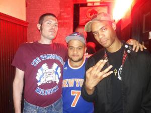 A scene from last night's outing of the NYC Oi! Fest: Two men of color standing with a guy wearing the T-Shirt of the Wrongdoers, a Finnish Nazi band. This is why we call them boneheads.