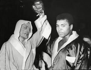 British Boxer Henry Cooper with Muhammad Ali, after Ali defeated him in 1963. Cooper went on to co-found the Anti-Nazi League.