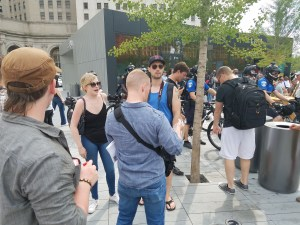 Rebecca, wearing the black blouse, and Matt Christensen, standing next to her with the baseball cap meet up with Nathan Damingo of Identity Evropa (formerly National Youth Front), in forefront, back turned to camera