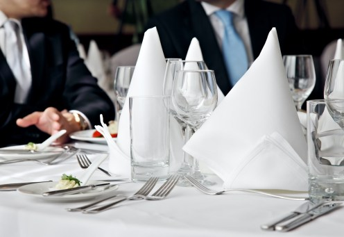two business people no faces over a restaurant table