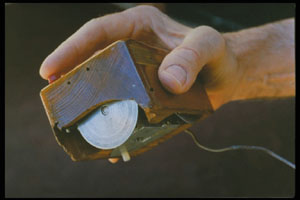The first computer mouse held by Engelbart sho...