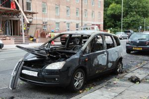 1024px-Liverpool_Riots_2011_damaged_car