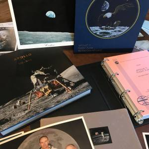 I have lots of stuff to show. On the right is a reproduction of the Apollo 11 Flight Plan. To the left is a new book (a Kickstarter campaign) that has incredible pictures from all the moon landing missions. Toward the bottom is a book my Aunt got me when she worked for a CBS affiliate... a very exclusive book about all their coverage of the moon landing. Just peaking out is a picture of the Apollo 11 crew. Do you know that astronaut's name?