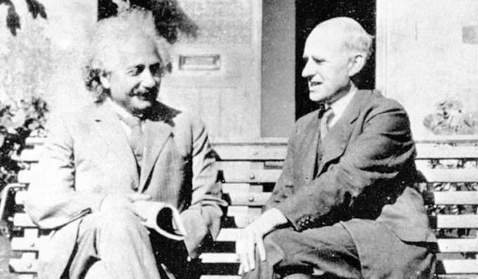 - Einstein and Eddington. German-born physicist Albert Einstein (1879-1955), at left, was famous for his theories of relativity. British astrophysicist Sir Arthur Eddington (1882-1944), at right, pionee -