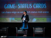 Cheryl and guest performer Jason demonstrate the principle of status in a game of Status Cards.