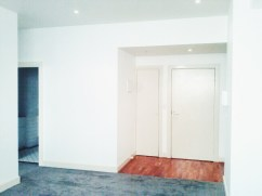 Henty House Unit 107 501 Little Collins Street Melbourne Entrance and living room view