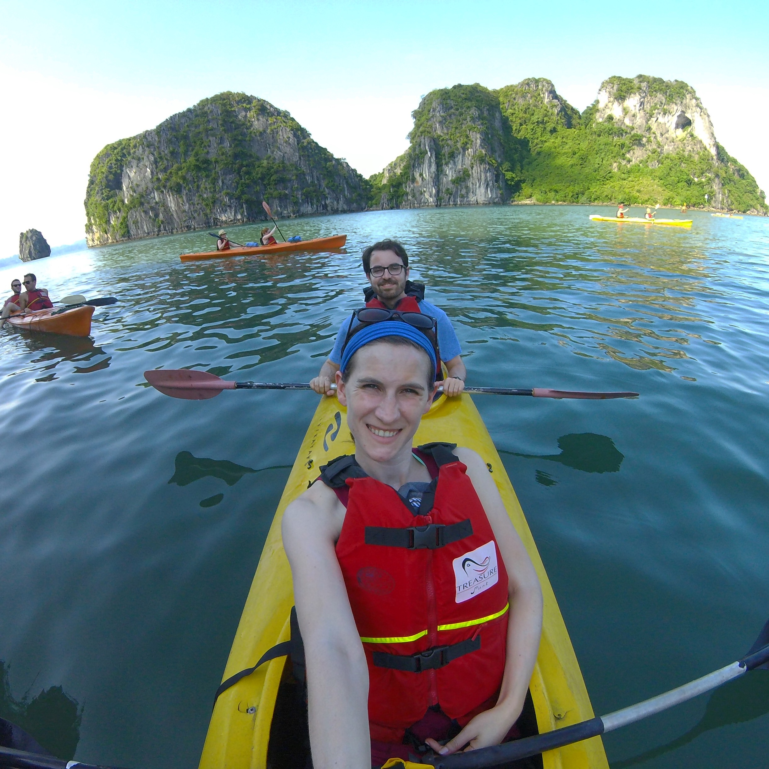Kayaking among the karst formations in Halong Bay