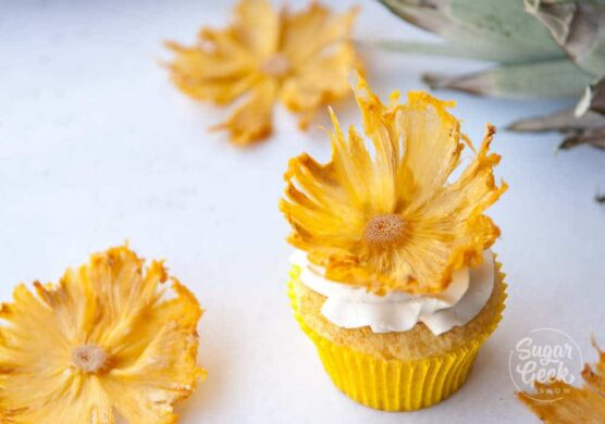 Decorate cupcakes with dried pineapple flowers