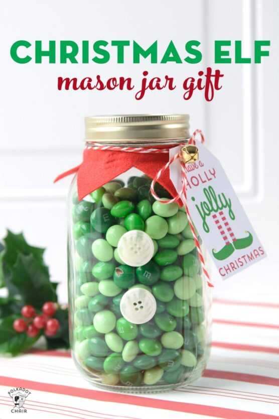 Green M&Ms inside a decorated glass jar