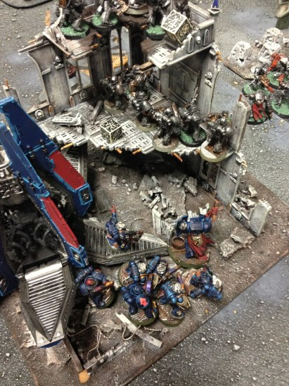 Pelayo and his Sternguard Veterans attack the Iron Masks