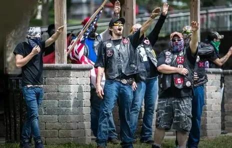 KKK members giving a Nazi salute