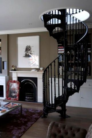Grey living room white mantelpiece fireplace digital abstract artwork art picture grey wall wrought iron spiral staircase real home L etc 03/2007 not used