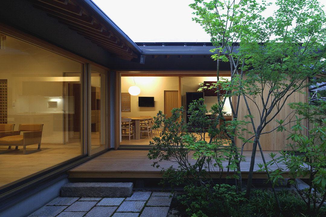 Timber-Framed Japanese House Built Around Private Gardens