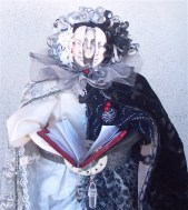 "2008 art doll depicting ""Life: The Black, The White, & The Grey"" using antique and vintage fabrics, trims. This is in a private collection."