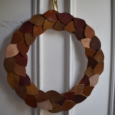 Autumn leaf wreaths made from leather scraps.