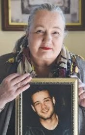 Karen Robinson holding photo of son Ben Picture taken by Andy Brownbill for Hume Leader 3rd Sept 2014 .png