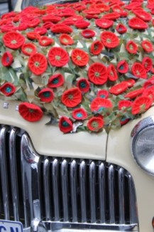 Photo No. 4 of 12 - Anzac Day March at Federation Square, Melbourne, Australia featuring Australia's first own car – its hood here blanketed with a sheath of poppies photo taken by Karen Robinson 25.4.2015.JPG