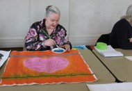 1 of 11 Art Therapy Session 31.8.2015 Karen Robinson - Abstract Artist painting on square canvas with acrylic paint being second stage in painting production for group project NB: All images are protected by copyright laws.jpg
