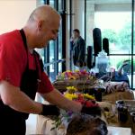 Owner slicing brisket at event