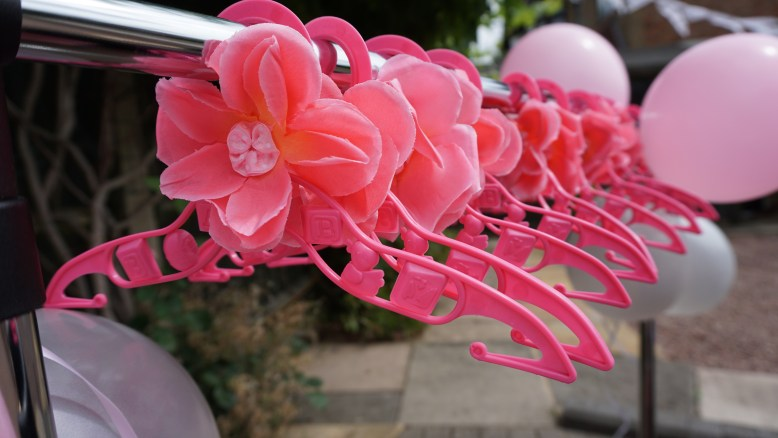 pink hangers Baby shower decoration ideas