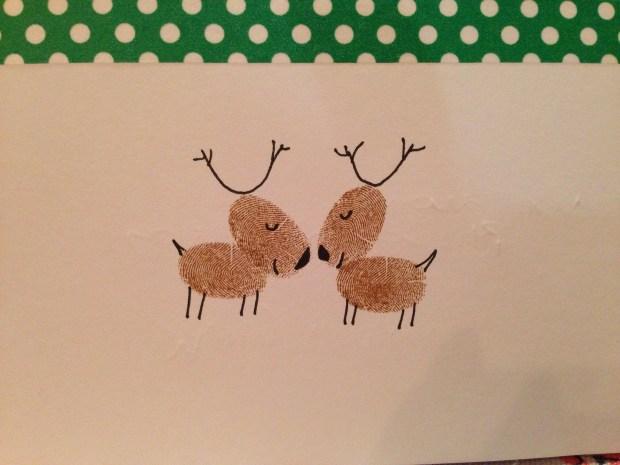 Handmade christmas card of Reindeer stamped with fingerprints