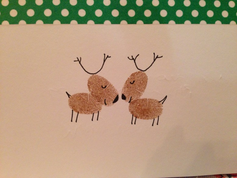 Handmade christmas card idea of Reindeer stamped with fingerprints