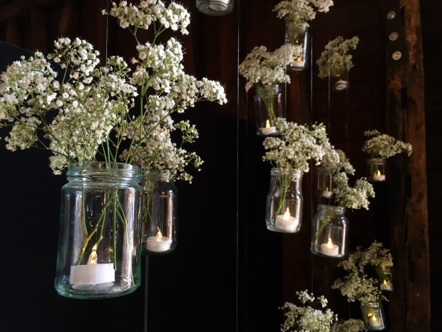 Hanging jars filled with flowers rustic barn wedding inspiration