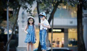 Boy and girl wearing IE9011 Revo mirror sunglasses