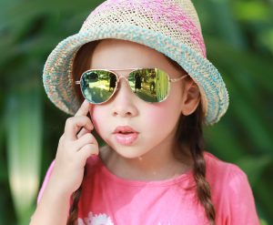 Girl wearing IE68038, gold frame with Revo mirror lens