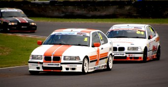 Nankang Tyres BMW Compact Cup eventual winner Steven Dailly 64 trails second placed James Gornall 1 in their E36 Compact 318TI cars around Quarry Corner on Sunday. https://idrismartin.wordpress.com/
