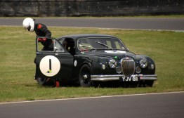 HRDC Coombs Heritage Trust competitor Michael Squire exits his 1958 Mk 1 Jaguar after spinning out at Quarry Corner on Sunday.