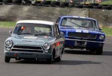 HRDC Coys Trophy eventual first and second placed cars, 77 1963 Lotus Cortina driven by father and son combination Mike and Andrew Jordan followed by 1964 Ford Mustang 22 with Michael Squire at the wheel at Quarry Corner on Sunday. https://idrismartin.wordpress.com/