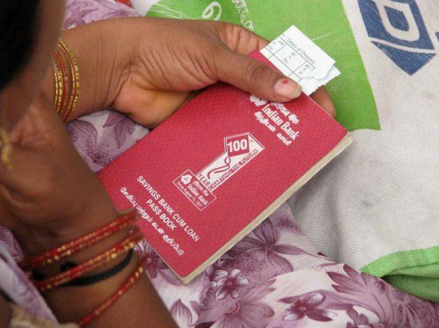Woman holding a passbook-women empowerment