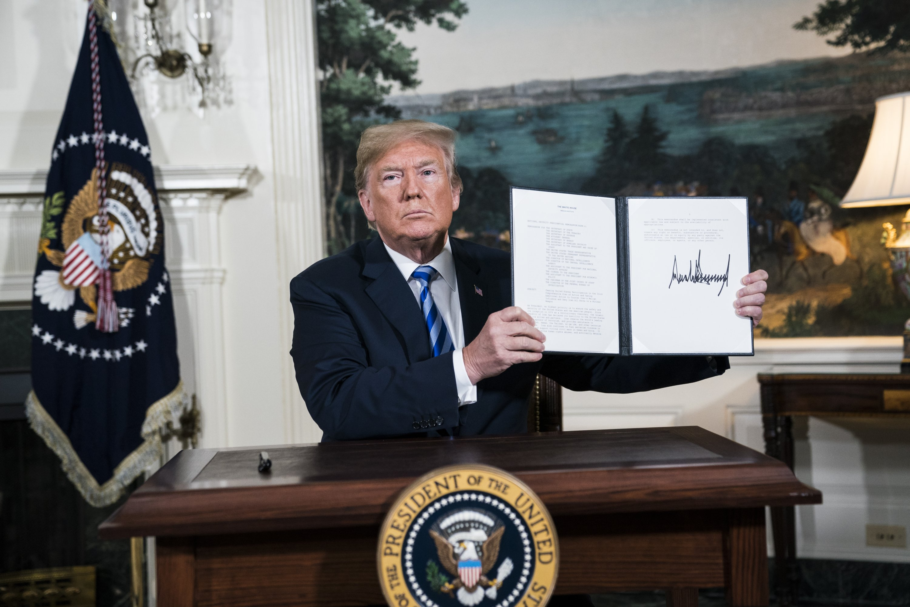 Then-U.S. President Donald Trump signs a presidential memorandum as he announces the U.S. withdrawal from the Iranian nuclear deal, at the White House, Washington, D.C., U.S., May 8, 2018. (Photo by Getty Images)