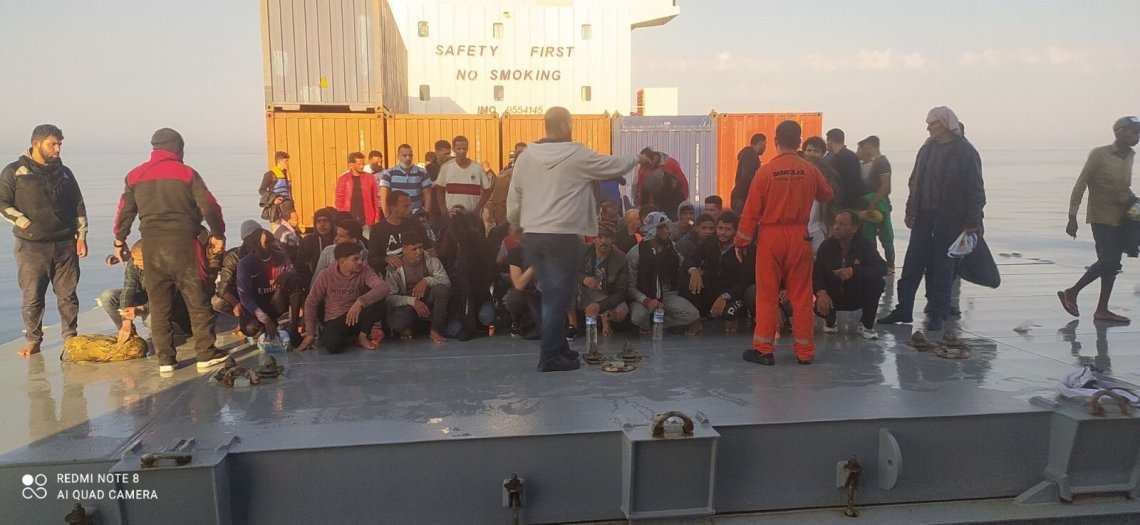Migrants saved by the Turkish captain rest aboard the vessel, off the coast of Malta, June 12, 2021. (DHA PHOTO)